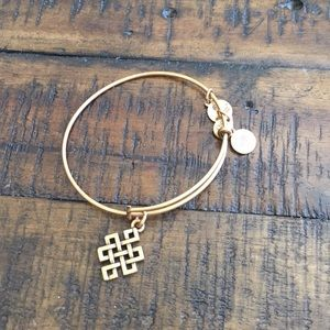 Alex and Ani gold bracelet with square knot charm